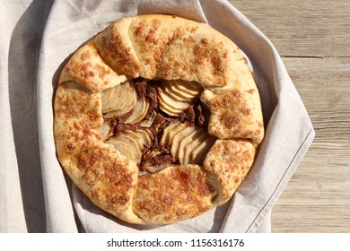 Tart with pear and almond filling and decoration. Top view, close-up.