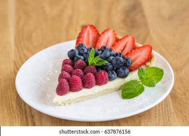 Tart with strawberries and raspberries and whipped cream