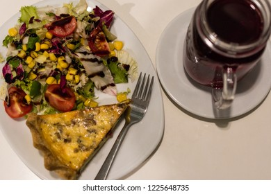 Tart - traditional polish pie with meat and salat and a cup of herbal tea