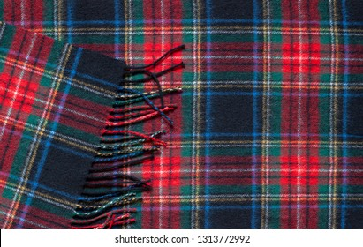 Tartan classic scottish pattern wool scarf background. Close up ornament