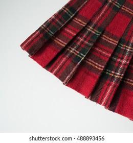 Tartan pleated skirt detail