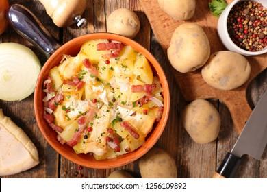 tartiflette, baked potato, bacon and cheese