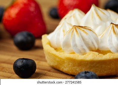 Tartlet with lemon curd  and meringue horizontal close-up