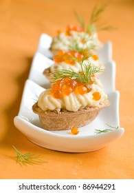 Tartlet with tuna creme and caviar for appetizer. Selective focus