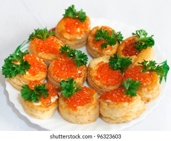 Tartlets with caviar and parsley on a plate