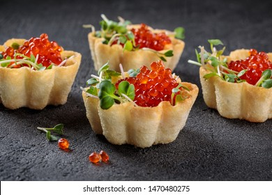Tartlets with cheese and red caviar