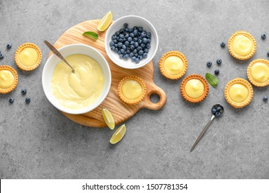 Tartlets with custard and blueberry, top down view, blank space for a text
