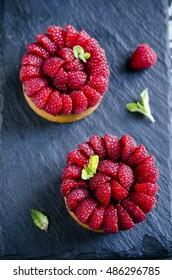 Tartlets with custard, fresh raspberries