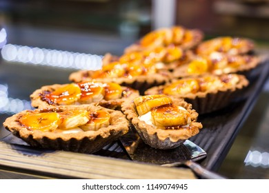 Tartlets with fresh bananas on black tray - Shutterstock ID 1149074945