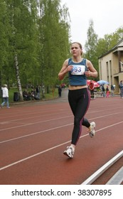 TARTU, ESTONIA - MAY 20: Athlete running along the track and taking part in Student Sell Games, organized by Estonian Academic Sports Federation in May 20, 2006