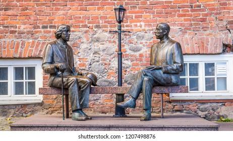 Tartu, Estonia - September 27, 2018: Bronze Sculpture of Oscar Wilde and Eduard Vilde near Kekskpark in the center of Tartu in Estonia