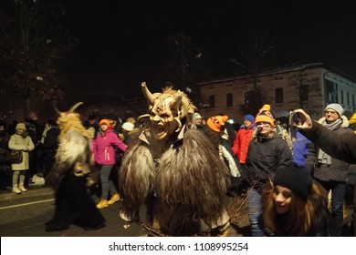 Tarvisio, Udine / Italy - December 5th 2017: Krampus raid in Tarvisio, Italy is traditional performance, happening every year on 5th of December. Men dress up in costumes spanking naughty children.