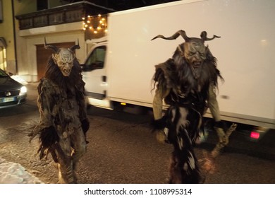 Tarvisio, Udine / Italy - December 5th 2017: Krampi running on streets of Tarvisio on the Krampus raid day.