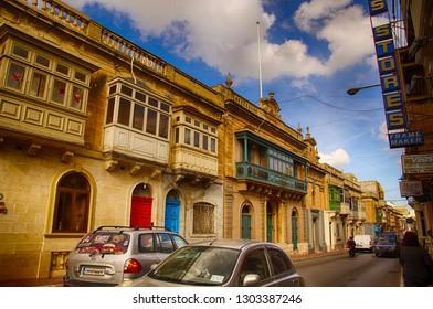 TARXIEN, MALTA - NOV 30, 2018 - Traditional balconies on Maltese apartment buildings, Tarxien, Malta