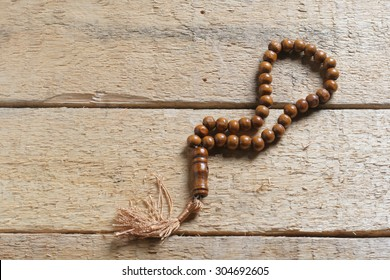tasbih (moslem prayer beads) at wooden board