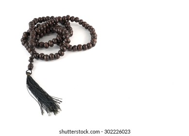 Tasbih or rosary on white background