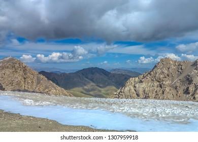 Tash Rabat Caravanserai Landscape with Snow Capped At Bashy Too Mountain Range Peak