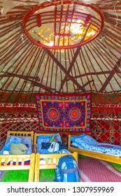 Tash Rabat Caravanserai Traditional Kyrgyz Yurt Interior with Felt Carpet Ornament and Sleeping Beds
