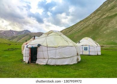 Tash Rabat Caravanserai Traditional White Colored Kyrgyz Yurt Camp with Ornament and Landscape