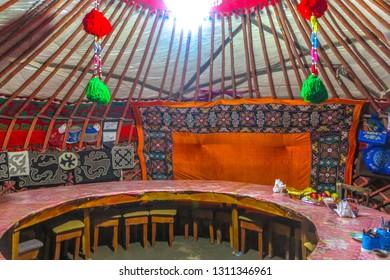 TASH RABAT, KYRGYZSTAN - JUNE 2017:  Caravanserai Traditional Kyrgyz Yurt Interior Guest Room with Felt Carpet Ornament