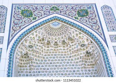 Tashkent, Uzbekistan - 27 Apr 2018: Facade of Minor Mosque (known as White Mosque, 2014). Beautiful oriental ornament & muqarnas (stalactites) on vaulting ceiling of mihrab.