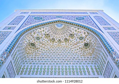 Tashkent, Uzbekistan - 27 Apr 2018: Facade of Minor Mosque (known as White Mosque, 2014). Wonderful oriental ornament & muqarnas (stalactites) on vaulting ceiling of mihrab. Words: 'Allah is great'