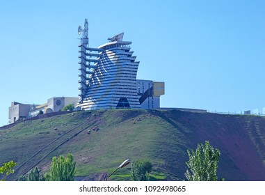 Tashkent, Uzbekistan - 28 Apr 2018: Solar furnace (known as Sun Institute), second largest in world, twin of Odeillo solar furnace (France). View of giant sun concentrator on mountain & heliostats.