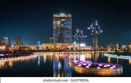 Tashkent, Uzbekistan - 30 October, 2019: Tashkent City Park illuminated at night with reflection in pond