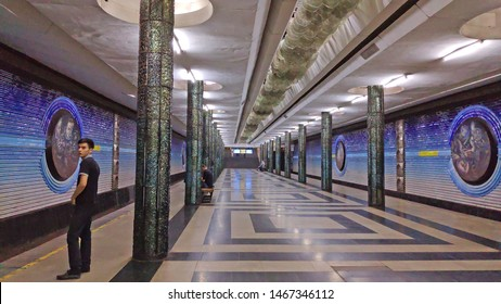 TASHKENT, UZBEKISTAN - AUGUST 01, 2019: Interior of Cosmonauts Metro Station in Tashkent, Uzbekistan.On the walls you can spot the likes of Yuri Gargaran and Valentina Tereshkova.