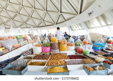TASHKENT, UZBEKISTAN - AUGUST 22, 2018: Dried fruits and nuts on local food market in Tashkent, Uzbekistan