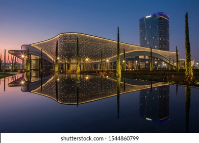 Tashkent, Uzbekistan.29.10.2019. View of the Congress hall and Hilton hotel with reflection in the water