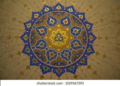 TASHKENT,UZBEKISTAN - OCTOBER 12,2016:Spiritual and ritual symbol of Islam,Arabic, Indian religions.Oriental motifs.Golden Mandala.Round Ornament Pattern on blue background.Geometric circle element
