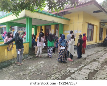 """Tasikmalaya, Indonesia 23 February 2021 - The people of Tasikmalaya city queue to get social assistance from the government.  """"Bantuan Sosial Tunai (BST)"""""""