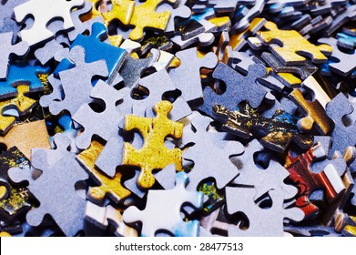 Task too difficult: pile of jigsaw puzzle pieces