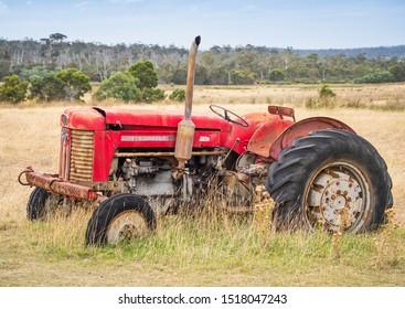 TASMANIA, AUSTRALIA - MARCH 8, 2019: An abandoned Massey Ferguson tractor on a farm in the Little Swanport area of Tasmania in Australia.