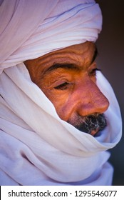 TASSILI N'AJJER, ALGERIA - JANUARY 10, 2002: Unknown man  in the sand dunes of the Algerian Sahara desert, Africa, Tassili N'Ajjer National Park