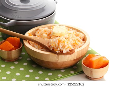 Taste rice porridge with pumpkin, isolated on white