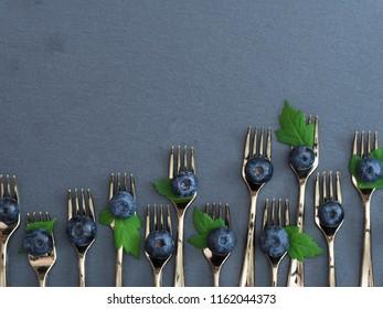 tasteful blueberries on the forks