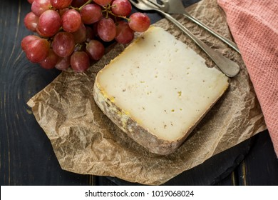 Tasting of ancient french demi soft cheese Tomme from French Alps, made from cow, goat or sheep skim milk, low fat french cheese close up