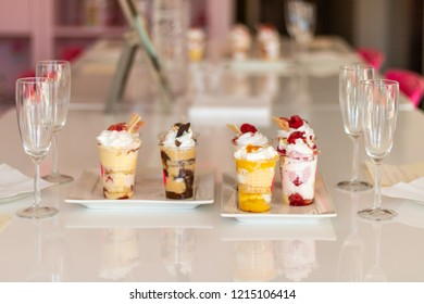 Tasting cups on each side with champagne glasses. tastings for weddings and the bride