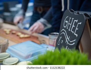 Tasting samples of Ghee at a Farmers' Market. Ghee is a class of clarified butter that originated from the Indian subcontinent. It is commonly used in South Asian and Middle Eastern cuisines,