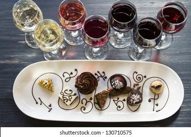 Tasting of wine and pattie chocolate pastries.