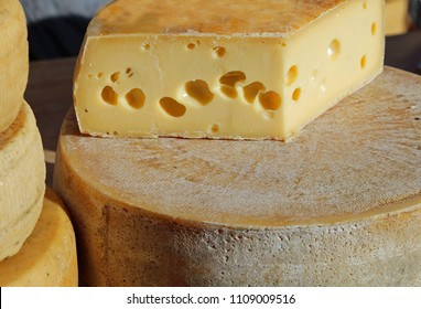 tasty aged cheese with holes for sale in the market