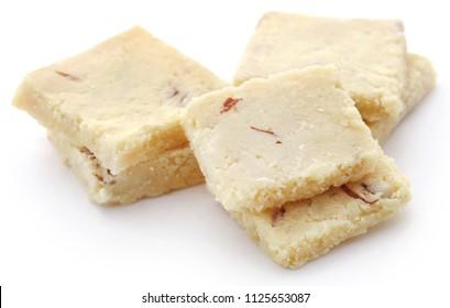 Tasty almond barfi over white background