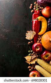Tasty appetizing fresh autumn seasonal vegetables fruits on wooden old green background top view above copy space