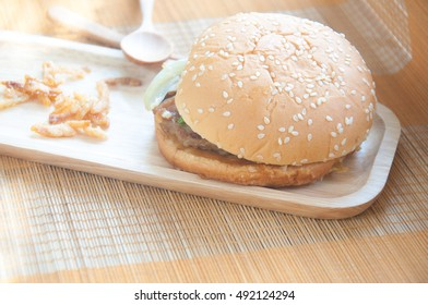 Tasty and appetizing hamburger in wood tray