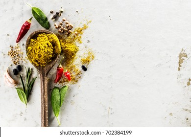 Tasty appetizing indian asian Food Ingredients Spices Flat Lay Wooden Spoon on White Background Top View Copy Space Above Cooking Healthy Food concept