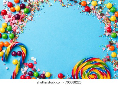 Tasty appetizing Party Accessories Happy Birthday Sweet Treat Swirl Candy Lollypop Colorful Letters on Bright Background Top View Fashion Conceptual Holiday Flat Lay
