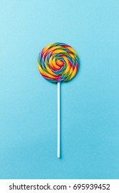 Tasty appetizing Party Accessory Sweet Treat Swirl Candy Lollypop on Bright Background Top View Minimalism Fashion Conceptual