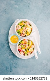 Tasty appetizing salad with prawns served in small bowls on table with sauce. Ready to eat. Detox Clean Eating Concept